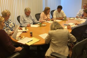 The EACBA Board of Directors are busy at work during the monthly board meeting.